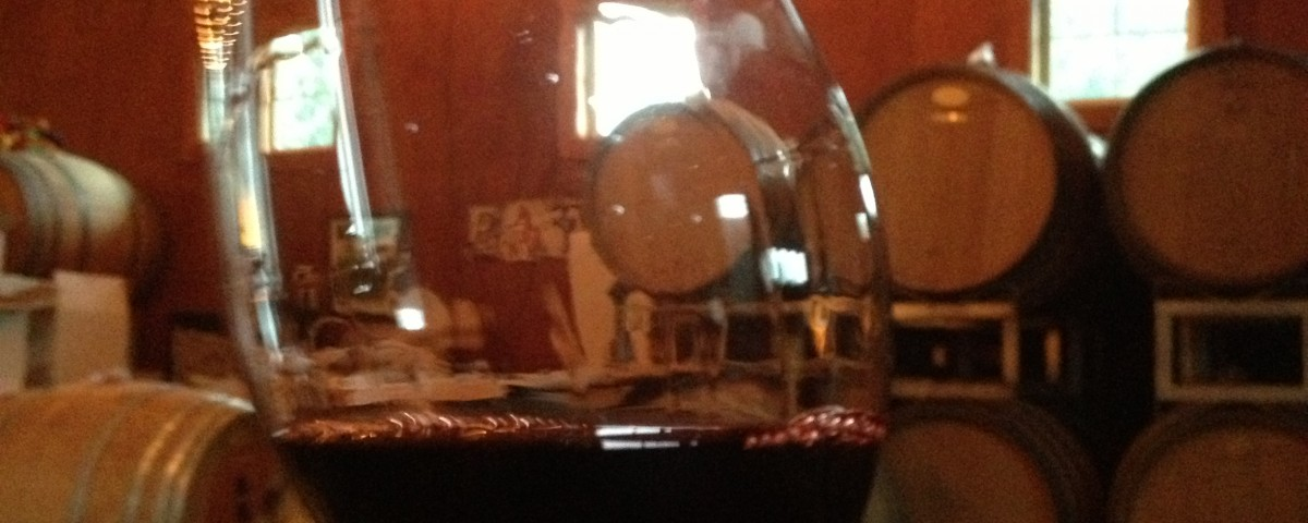 Wineglass half-filled with red wine